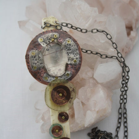"Mixed Metal Cross Pendant Rutilated quartz, roman glass, fosillized tusk on 18"" sterling chain."